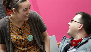 Revitalise guest and carer laughing