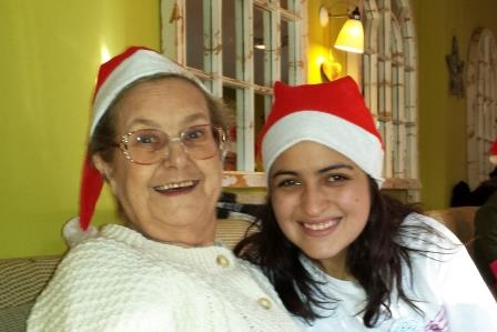 Guest and volunteer wearing christmas hats
